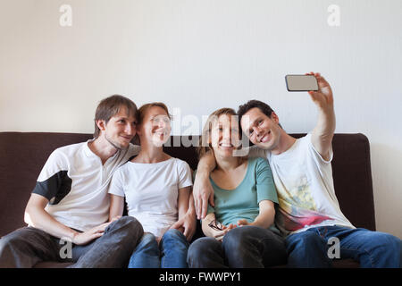 group of friends taking photo of themselves, home party, selfy - Stock Photo