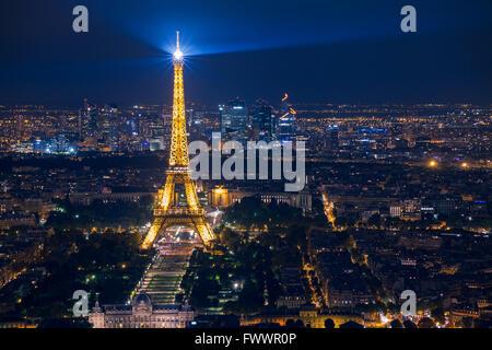 beautiful night scene of illuminated Eiffel Tower and panoramic aerial view of Paris, France - Stock Photo