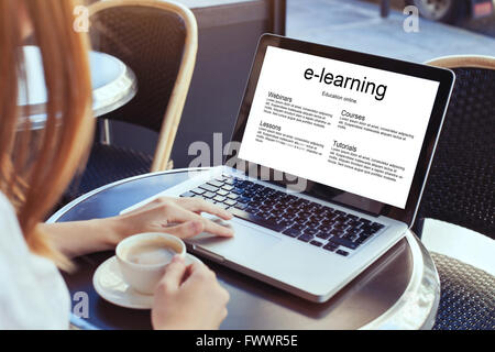 e-learning, education online concept, woman with laptop - Stock Photo