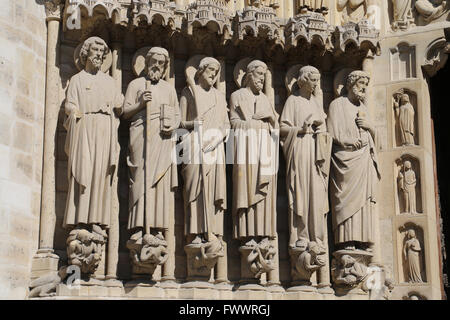 France. Paris. Western facade, Cathedral of Notre-Dame.13th century.  Portal of the Last Judgement, Apostles left. - Stock Photo