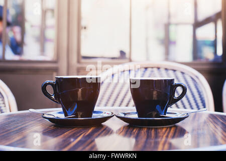 two cups of coffee on the table in cafe in Paris - Stock Photo