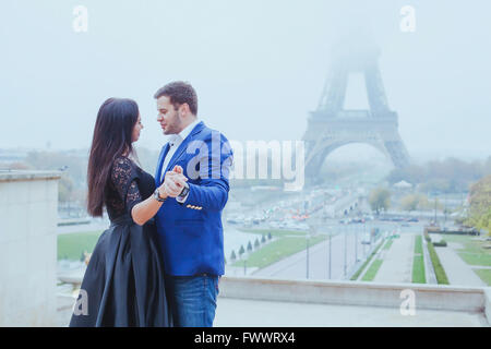 romantic moment near Eiffel tower, portrait of couple in love - Stock Photo