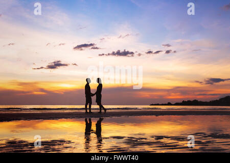 silhouette of affectionate couple on the beach at sunset, love concept, man and woman, beautiful background