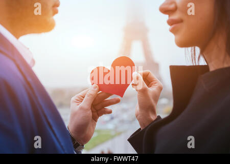 love and romance, couple on honeymoon near Eiffel Tower in Paris, heart for Valentines day - Stock Photo
