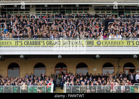 Isolated large crowds at Liverpool, Merseyside, UK 7th April, 2016. Grandstand, racecourse, sport, horse, track, - Stock Photo