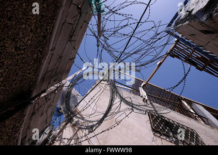 Jerusalem, Israel. 7th April, 2016. Barbed wire fence surrounding a building that Jewish settlers acquired and call - Stock Photo