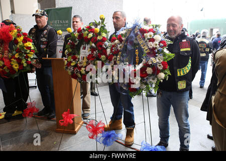 New York City, NY, USA. 2nd Apr, 2016. Nam Knights of America motorcycle club members stand behind wreaths during - Stock Photo
