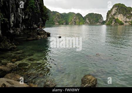 Wild cove in Bai Tu Long area of Ha Long Bay, Quang Ninh Province, Vietnam - Stock Photo