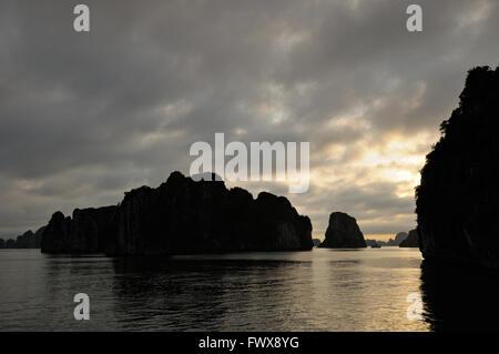 Sunset in Bai Tu Long area of Ha Long Bay, Quang Ninh Province, Vietnam - Stock Photo