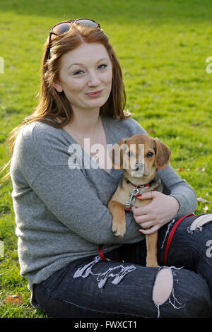 portrait of a young woman with her small dog - Stock Photo