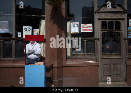 A programme seller on duty outside the Boleyn pub, a regular gathering place for home fans visiting the Boleyn Ground, - Stock Photo