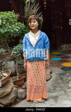 Young girl having made herself up with thanaka (Nyaungshwe). This plant powder is now used by City Burmese women - Stock Photo