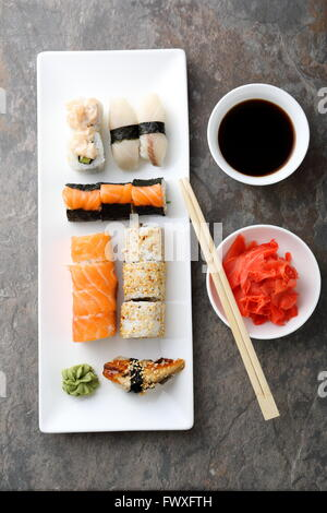 set of sushi on plate and chopsticks - Stock Photo