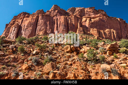 Sandstone cliffs over Burr Trail Road in Long Canyon, Grand Staircase-Escalante National Monument, Utah, USA - Stock Photo