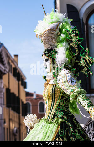Beautiful woman mask posing during the Carnival in Venice. - Stock Photo