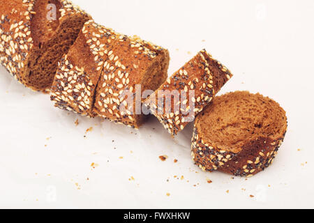 sliced wholegrain baguette with poppy and sesame - Stock Photo