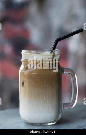 Iced coffee with milk and straw - Stock Photo