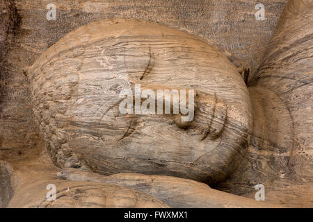 Sri Lanka, Polonnaruwa, Gal Vihara, head of reclining Buddha resting on carved pillow - Stock Photo