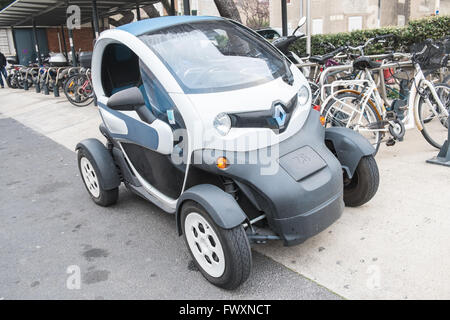 france paris smart cars in a paris street a golf cart size vehicle stock photo royalty free. Black Bedroom Furniture Sets. Home Design Ideas