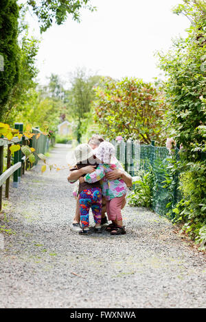 Sweden, Vastra Gotaland, Gothenburg, Mother hugging daughter (2-3) - Stock Photo