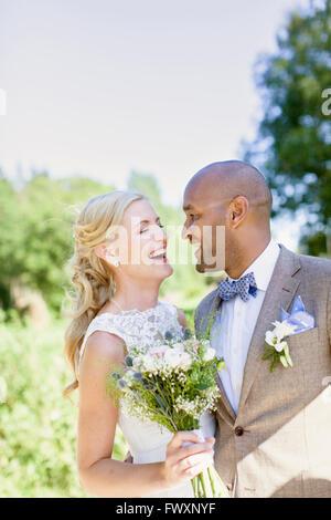 Sweden, Smaland, Mullsjo, Smiling newly wed couple - Stock Photo
