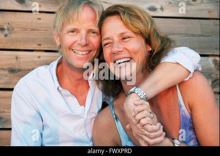 Sweden, Stockholm, Sodermanland, Dalaro, Portrait of mature couple embracing - Stock Photo