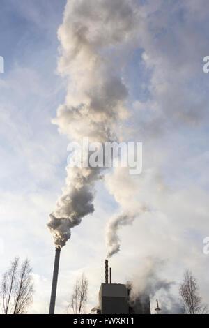 Sweden, Ostergotland, Skarblacka, Smoke coming from smoke stacks - Stock Photo