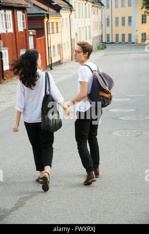 Sweden, Stockholm, Sodermalm, Nytorget, Young couple walking down street - Stock Photo