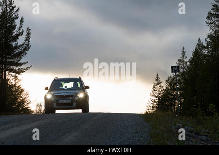 Sweden, Harjedalen, Storsjo, Car on road under overcast sky - Stock Photo