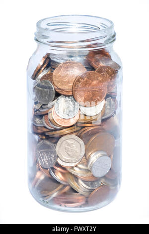 Savings jar full of coins, UK. - Stock Photo