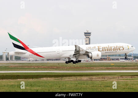 Emirates Airlines, Boeing 777-300 at Linate airport, Milan, Italy - Stock Photo