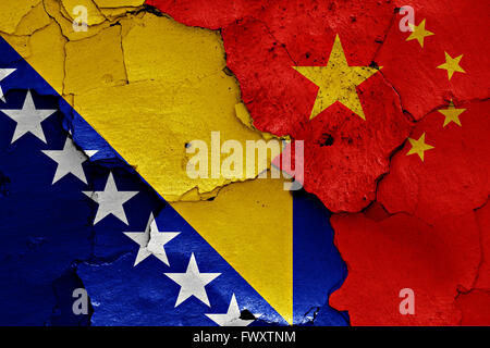 flags of Bosnia and Herzegovina and China painted on cracked wall - Stock Photo