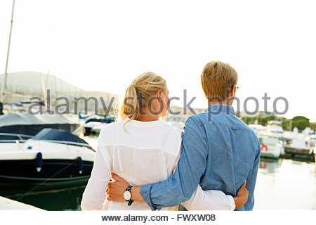 France, Provence-Alpes-Cote d´Azur, Sainte-Maxime, Rear view of young couple on pier - Stock Photo