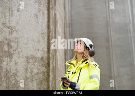 Sweden, Vastmanland, Engineer working at construction site - Stock Photo