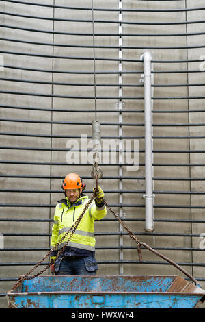 Sweden, Vastmanland, Construction worker standing inside water tower - Stock Photo