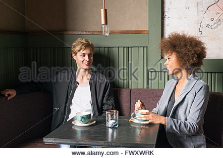 Sweden, Vastra Gotaland, Young couple in cafe - Stock Photo