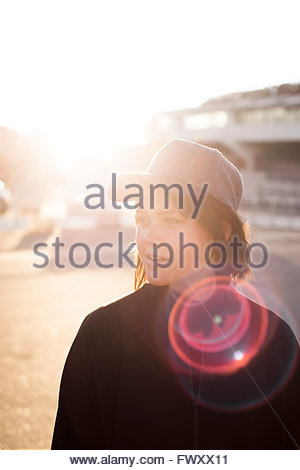 Sweden, Vastra Gotaland, Gothenburg, Young woman looking away - Stock Photo