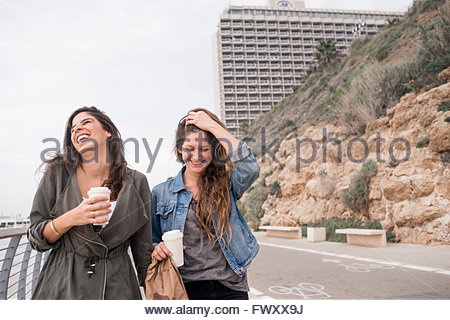 Israel, Tel Aviv, Two smiling women on promenade - Stock Photo