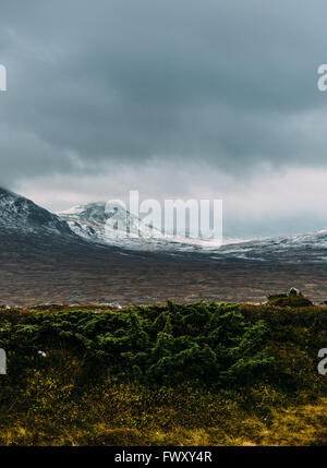 Sweden, Sylama, Jamtland, Landscape with snowcapped mountains and overcast sky - Stock Photo