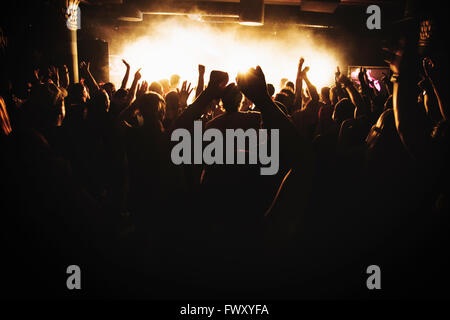 Finland, Silhouettes of people dancing at concert - Stock Photo