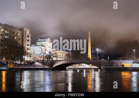 Finland, Pirkanmaa, Tampere, Night city scene with brick bridge - Stock Photo