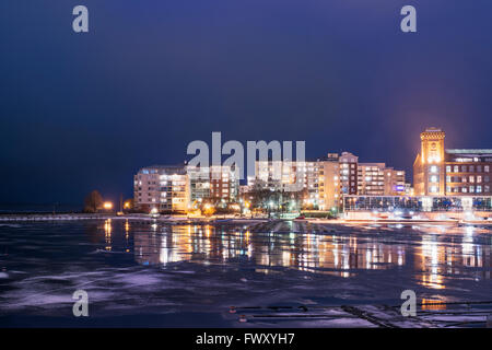Finland, Pirkanmaa, Tampere, Illuminated cityscape a night - Stock Photo