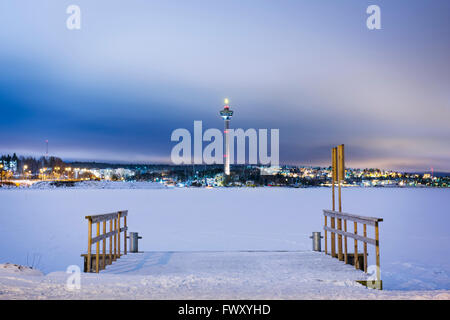 Finland, Pirkanmaa, Tampere, Winter scene with frozen lake and communication tower - Stock Photo