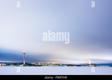 Finland, Pirkanmaa, Tampere, Winter scene with city and communication tower in background - Stock Photo