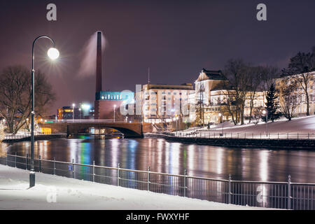 Finland, Pirkanmaa, Tampere, Winter urban scene with riverbank - Stock Photo