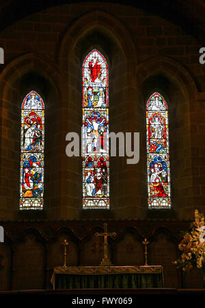 Stained glass window in St Lawrence's parish Church Eyam Derbyshire England UK - Stock Photo