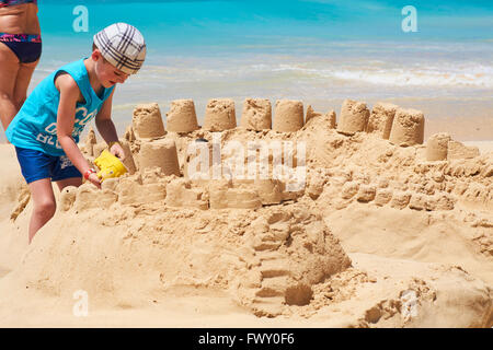 Small Boy Building A Sandcastle On Praia de Lacacao Beach Boa Vista Cape Verde Islands Africa - Stock Photo