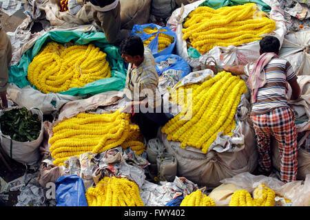 Flower market near Howrah bridge, Kolkata, India. - Stock Photo