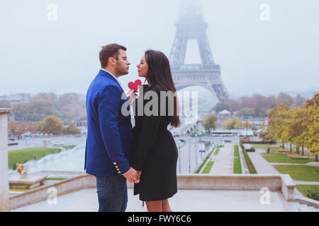Valentines day travel destination, couple in love near Eiffel Tower, Paris, France - Stock Photo