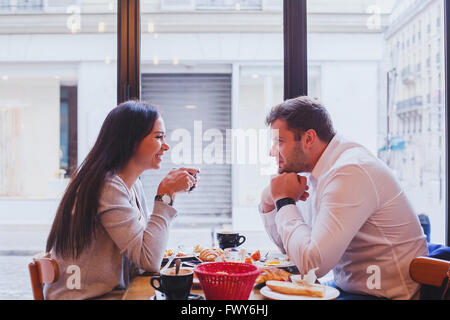 eating in restaurant, happy smiling couple having lunch in cafe, dating - Stock Photo